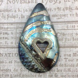 Ceramic Raku Jewelry Piece created by Marianne Kasparian