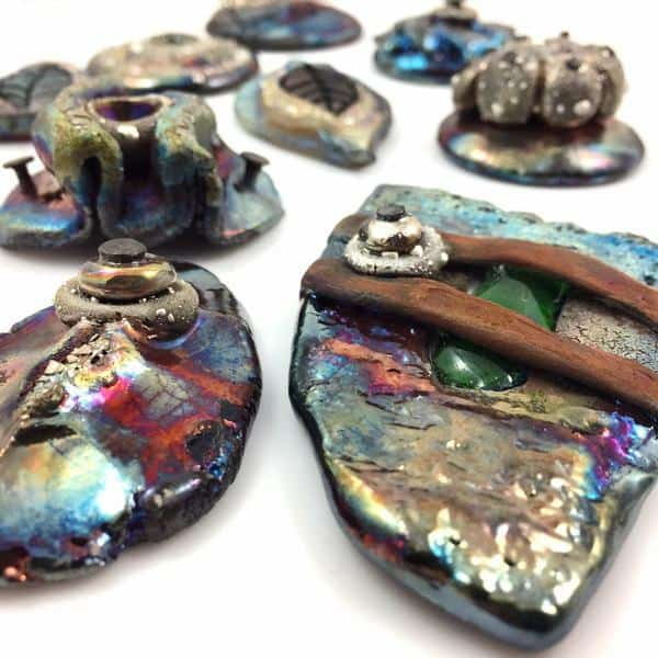 Ceramic Raku jewelry pieces created by Marianne Kasparian